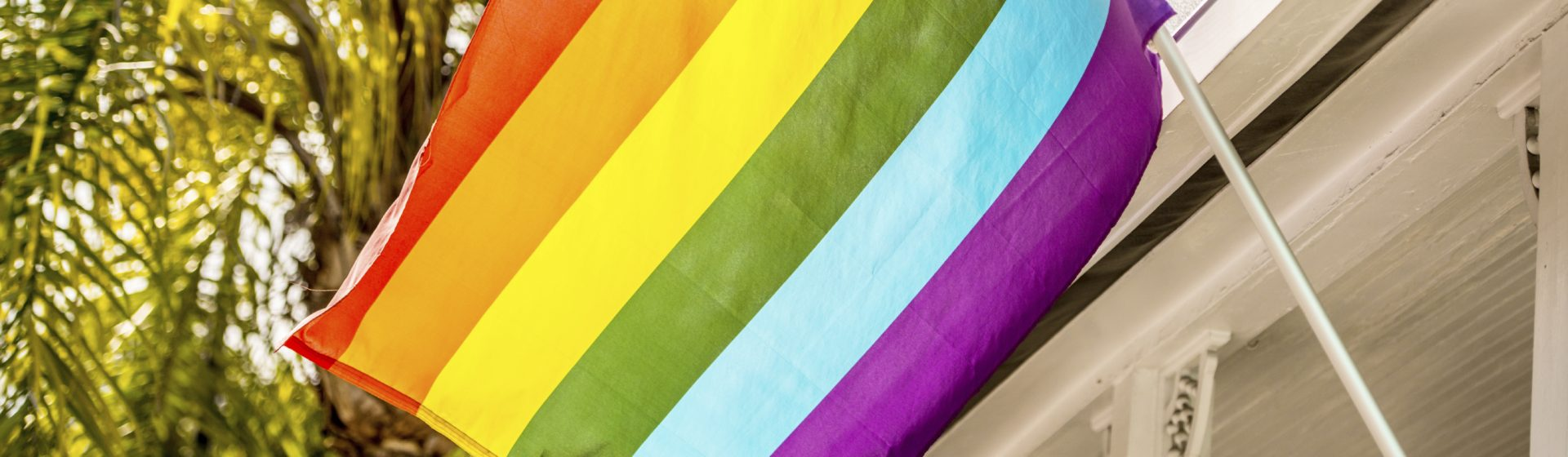 Close-up of a rainbow flag.