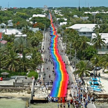 Massive rainbow flag stretching down at entire road during the Pride celebration in Key West.