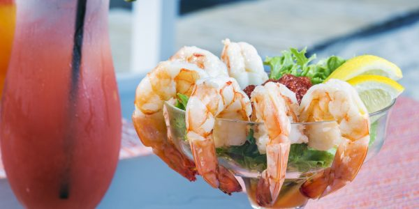 Shrimp cocktail and a frozen drink.